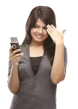 beautiful indian girl face: Modern indian teenage girl with cell phone Stock Photo