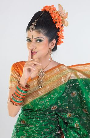 quite: lady saying quite with green silk sari