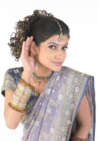 girl with gorgeous sari and bangles in a hearing expression pose photo