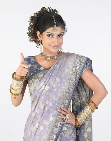 silver dress: Asian woman in rich sari showing her finger