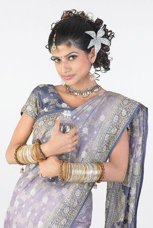 Indian girl in rich sari with water bottle photo