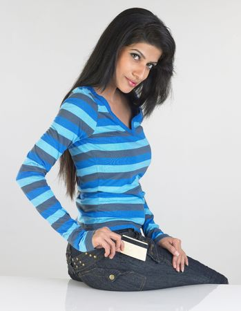 Teenage girl in blue stripes T-shirt with the credit card photo