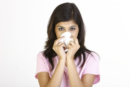 sniffle: Teenage girl with tissue suffering with cold Stock Photo