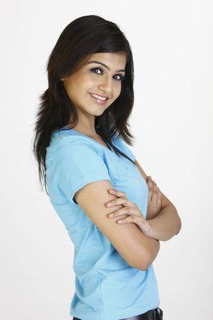 sidewards: Happy girl in blue T-shirt standing sidewards