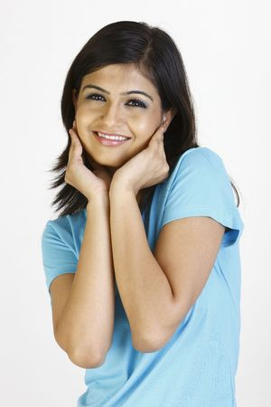 sidewards:  girl in blue T-shirt standing with happiness