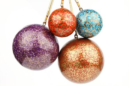 four different size of christmas balls photo