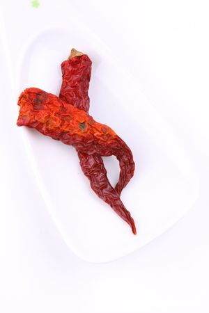 intense flavor: two dry red chillies Stock Photo