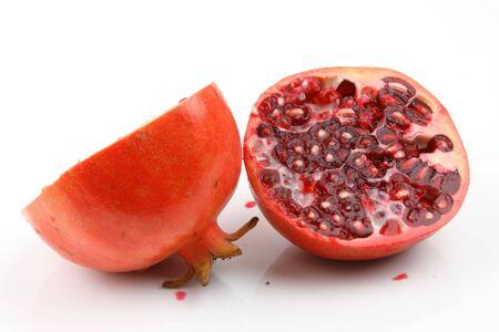 half cut:   Fresh half cut red pomegranate Stock Photo