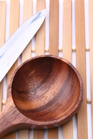 wooden spoon with sharp knife photo