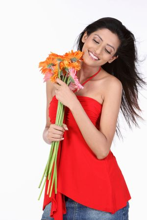 teenage girl with orange daisy flowers Stock Photo - 6148742