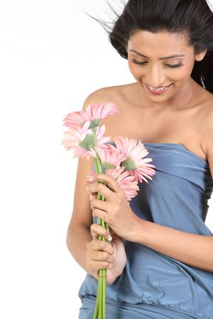 young beauty girl in gray dress with pink daisy flowers Stock Photo - 6148634