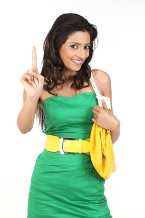 attractive young girl in beautiful green dress showing her finger photo