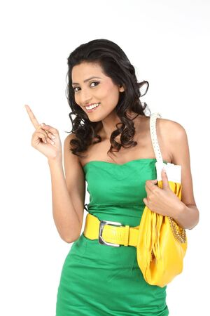 young girl in beautiful green dress showing her finger photo