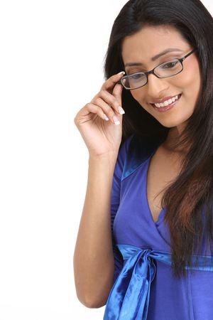 Happy teenage girl with eyeglasses isolated on white background photo