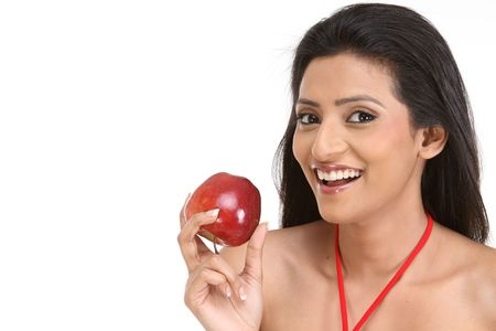 smiling teenage girl with red apple photo