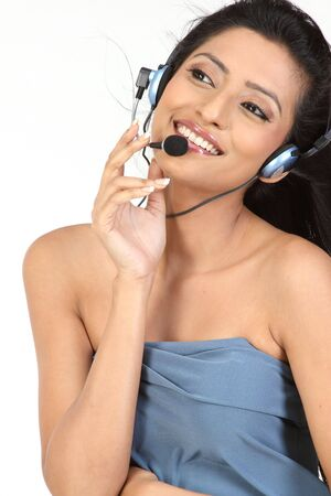 Portrait of beautiful girl in sleeveless dress talking over micro phone photo