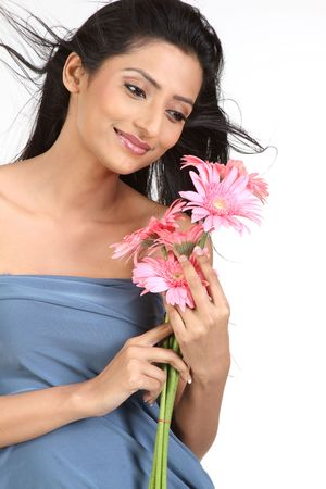 Young beautiful woman with pink flowers isolated on white photo