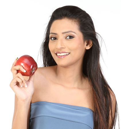 Beautiful young girl holding apple reminding you to keep a healthy diet photo