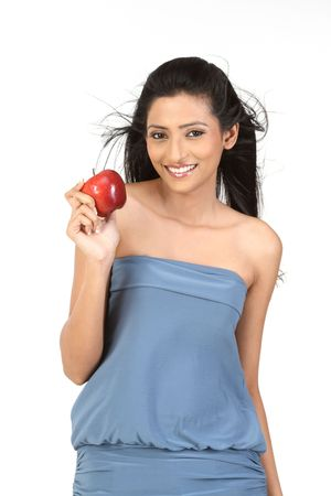 Smiling young girl holding apple reminding you to keep a healthy diet. photo