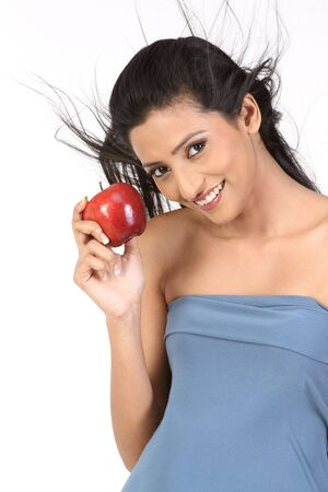 Teenage girl with red apple photo