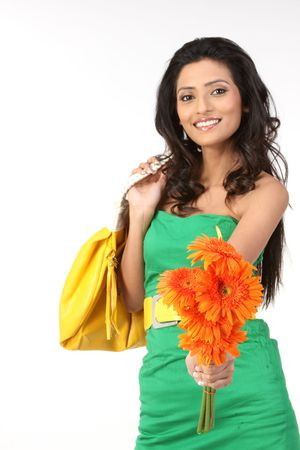 black hair young woman with orange daisy flowers photo