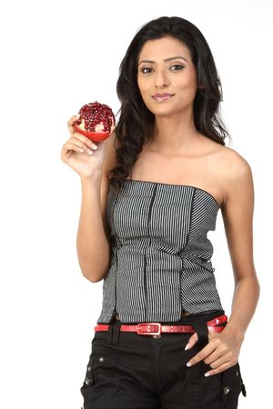 Studio shot of beautiful young adult holding pomegranate photo