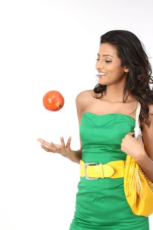 Beautiful girl catching the pomegranate photo