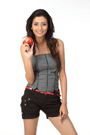 slim girl holding red apple photo