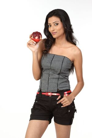 beautiful young adult holding pomegranate photo