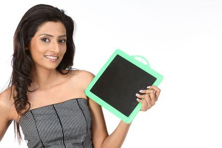 Teenage girl with empty slate photo