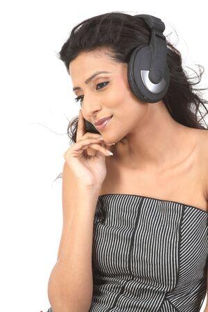 beautiful girl enjoying music with the head phones Stock Photo - 6149622