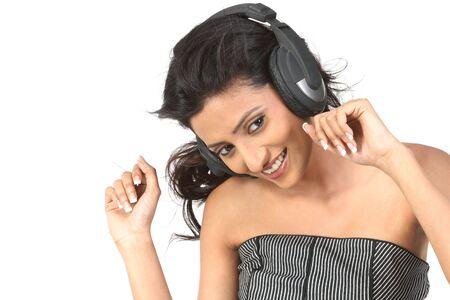 teenage girl enjoying music with the head phones Stock Photo - 6162119