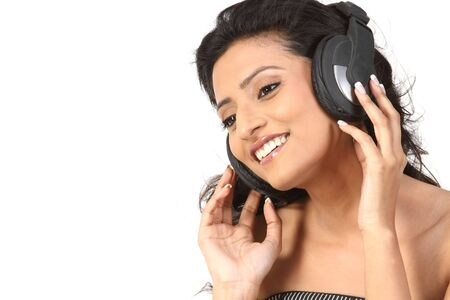 Closeup of teenage girl hearing music with head phones Stock Photo - 6162031