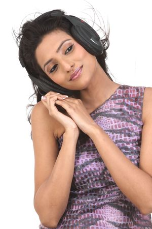 girl sitting in chair enjoying music with the head phones Stock Photo - 6162112