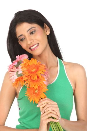 teenage girl with orange and pink daisy flowers Stock Photo - 6162125