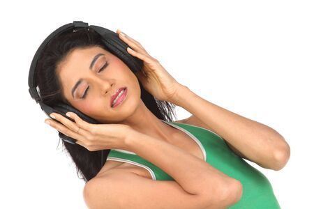 girl enjoying music with the head phones Stock Photo - 6162029