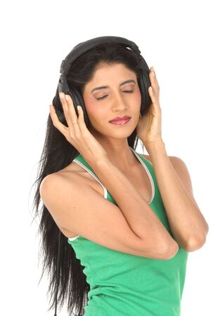 teenage girl enjoying music with the head phones Stock Photo - 6162101