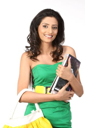 Beautiful girl with handbag and books