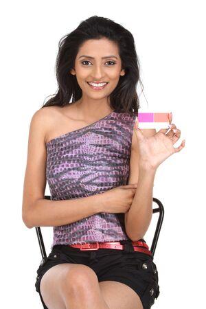 Girl holding credit card on white isolated background photo