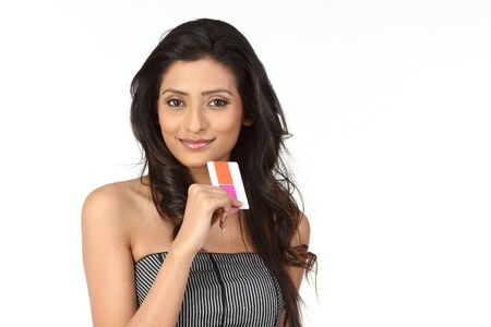 Woman holding Credit Card photo