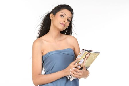 Pretty smiling woman holding books photo