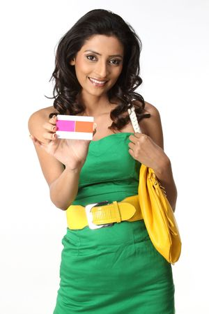 indian girl holding pink credit card photo