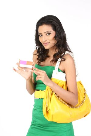 business Woman holding pink credit card photo