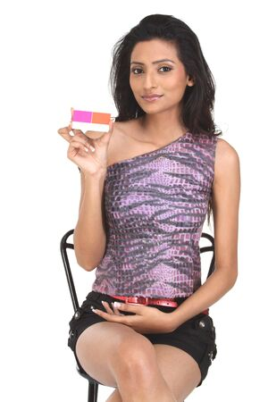 Girl holding credit card on white isolated background photo