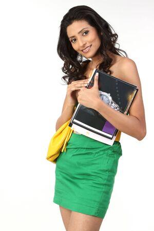 Beautiful girl with handbag and books photo