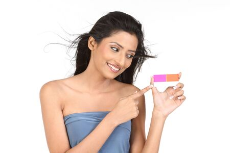 Woman showing her pink credit card photo