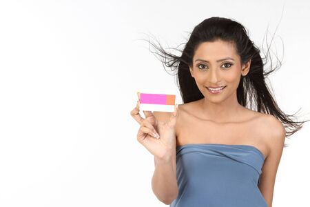 Indian Woman showing her pink credit card photo