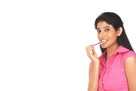 Woman holding the credit card in her mouth photo