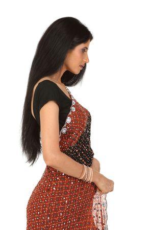 sidewards: Woman in sari standing sidewards in white background