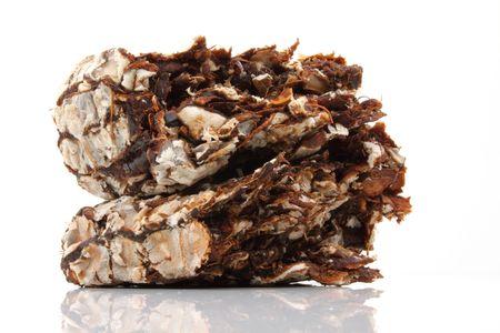 acidic: Fresh brown tamarind on white background